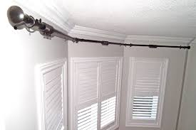how to put up curtain rods in a bay window curtain gallery images inquietudes me