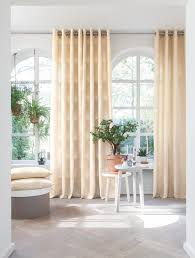 Should Curtains Touch The Floor Or Window Sill How And Where Are Curtains Supposed To Hang Russells Curtains
