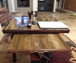 resin top reclaimed wood coffee table with slide out tv tray and