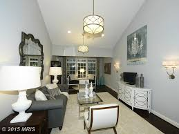 art deco living room with pendant light u0026 wall sconce zillow
