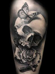 skull flower cross and butterfly design