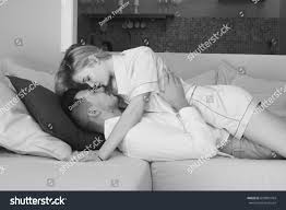 young caucasian couple lying sofa living stock photo 639881764