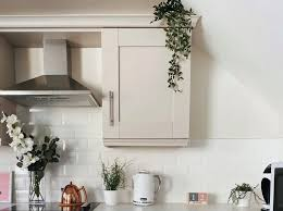 top of kitchen cabinet greenery is greenery above kitchen cabinets outdated with ideas for