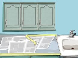 Can You Paint Particle Board Kitchen Cabinets by How To Paint Oak Cabinets 15 Steps With Pictures Wikihow