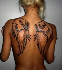 black wings on the back tattoomagz