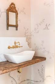 floating vanity with vessel sink whimsical powder room boasts walls clad in fromental wallpaper lined