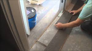 Tile To Laminate Floor Transition Trick Flat Hardwood Floor Transition Installation Between Room And