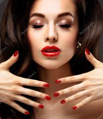 red lips and nails closeup manicure and makeup make up