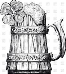 wooden beer mug decorated with celtic pattern and four leaf clover