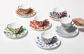 mirror teacups reflect colorful patterns from the saucers they u0027re