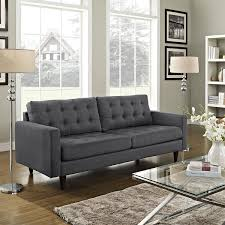 living room grey couches with brown wooden floor and small glass