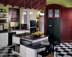 ge profile kitchen with black appliances green walls and white