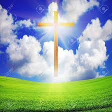 shiny wooden easter cross green field and blue sky with