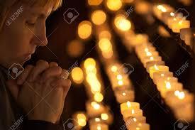 vigil lights catholic church woman praying in catholic church stock photo picture and royalty