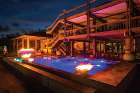 contemporary home swimming pools at night o with decor