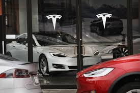 tesla rivals gm as the most valuable auto maker in u s wsj