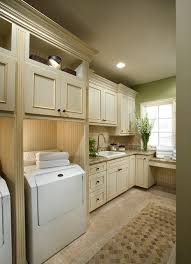 custom laundry room cabinets framed cabinetry traditional laundry room portland by dewils