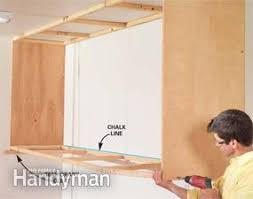 how to build plywood garage cabinets installing large garage cabinets family handyman