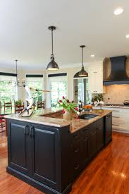 this large center island features black cabinetry and neutral