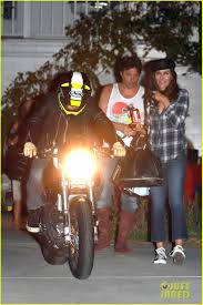 orlando bloom revs up his motorcycle after big halloween party