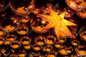 nightclub gold disco balls and glowing yellow in colorful