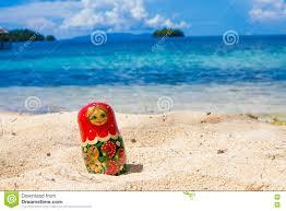 photo russian handmade dolls matrioshka untouched tropical beach