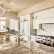 kitchen cabinet color with brown countertops using cambria quartz with veins in your home