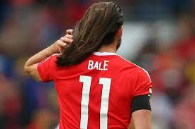 gareth bale new haircut gareth bale s hair falls out of his man bun during wales draw