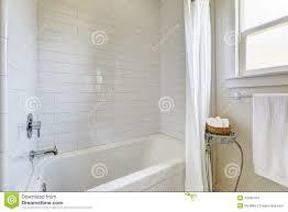 Simple Bathroom Simple Bathroom With Tile Wall Trim And Bath Tub Stock Photo
