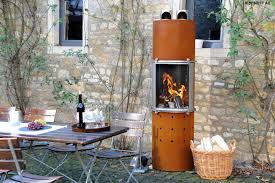 extend the summer in your own backyard with an outdoor fireplace