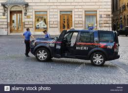 jeep police package two italian police officers on duty and standing by their jeep in