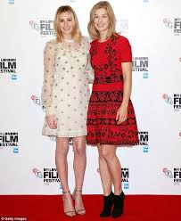 rosamund pike dons a funky red mini dress at bfi london film