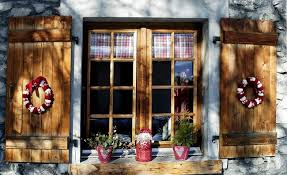 Macy S Christmas Window Decorations 2013 by Christmas Window Decoration Wooden Shutters Wreaths Red Pots