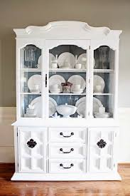 how to arrange a corner china cabinet tips on how to arrange a china cabinet average but inspired