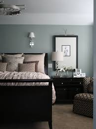 black furniture with walls that are blue with a green tint this