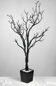4 foot black and white artificial manzanita trees in wood pot