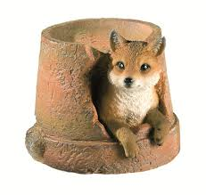 uk garden supplies fox in pot garden ornament