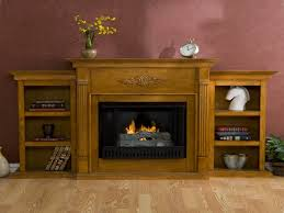 swinging bookcase gel fireplaces with bookcase fireplace mantels