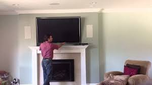 decor tv over fireplace using down and out mount you mounting