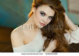puffy woman curly hair seductive sexy girl curly hair backlit stock photo 628842296