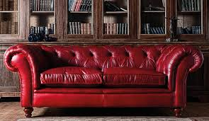 Victorian Leather Sofa Victorian Red Leather Tufted Coach With Ruched Armrest In Front Of