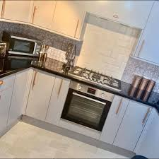 spray painting kitchen cabinets scotland diy novice transforms dull kitchen into bright space and