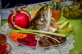 rosh hashanah seder plate rosh hashanah traditional dish with the fish pomegranate