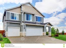 large two story house with siding two garage spaces and concrete