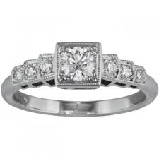 low profile vintage engagement ring with diamond band
