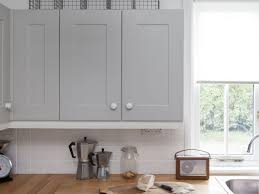 how to clean factory painted kitchen cabinets don t replace respray