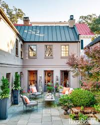 covered outdoor seating this colonial era charleston home masters the mix of old and new