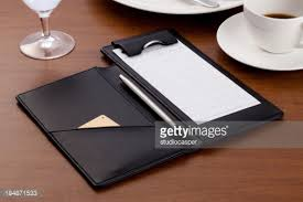 guest check tray guest check on tray stock photo getty images