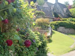 English Cottage Gardens Photos - english cottage garden with roses stock photography image 21340272