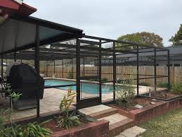 Backyard Flooring Options - swiming pools pool enclosure with patio furniture clearance also